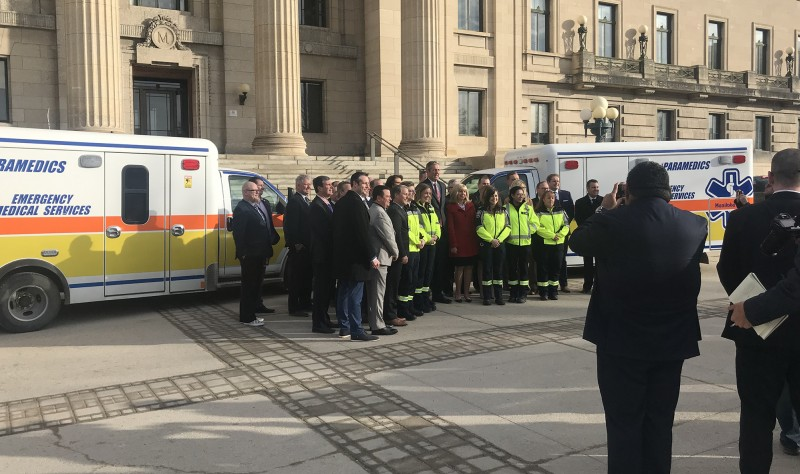 MLAs stand with paramedics at announcement