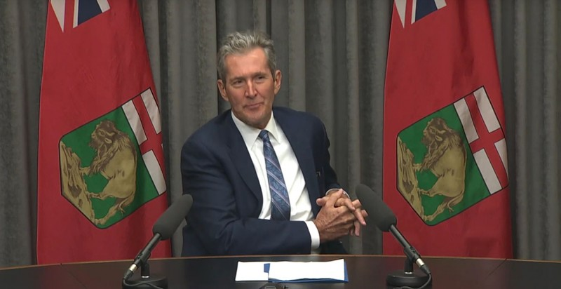Premier Pallister at desk
