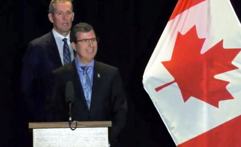 Premier Brian Pallister and Civil Service Minister Reg Helwer by Canadian flag